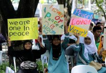 THE MEDIUM IS THE MESSAGE. Young Muslim girls hold placards on peace and unity during the peace walk for the prevention of violent extremism in time for the 4th Annual Commemoration of the Declaration of World Peace held at the People's Park in Davao City on Tuesday. The event was organized by Heavenly Culture, World Peace, Restoration of Light (HWPL) with the collaboration of the 11 tribes of Davao and Madrasah Comprehensive Development and Promotion Program (MCDPP). LEAN DAVAL JR.