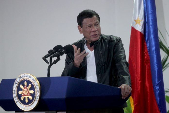 EMPHATIC. President Rodrigo Duterte gestures as he is stressing a point during a news conference upon his arrival at the Davao International Airport in Davao City from a state visit in the People's Republic of China early morning of Tuesday. LEAN DAVAL JR.