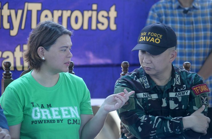 ON THE SAME PAGE. Davao City Mayor Sara Duterte-Carpio talks to Task Force Davao commander Colonel Erwin Bernard Neri while in a news conference at Camp Domingo Leonor. The city government of Davao led by Duterte-Carpio on Saturday issued a public advisory about an alleged terror plot in the city. LEAN DAVAL JR.