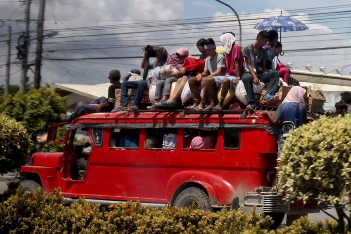 FILLED TO THE RAFTERS.A public utility vehicle is overflowing with passengers and merchandise while traversing along the national highway in Panabo City on Thursday. LEAN DAVAL JR.