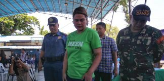 "HOT CONTRABAND. Davao City Mayor Sara Duterte-Carpio checks out suspected ""shabu,"" drug paraphernalia and guns confiscated during 'One Time, Big Time' operation conducted by the joint security enforcement forces in Davao City's 10 barangays on Friday. Five suspects were killed and 65 others were arrested in the operation. LEAN DAVAL JR."