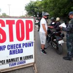 NO LET-UP. Police officers belonging to Sta. Ana Police Precinct conduct a random checkpoint along R. Castillo Street in Davao City on Friday afternoon as part of the ongoing heightened security measures being implemented in the city. LEAN DAVAL JR.