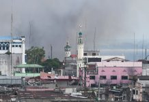 "NOT BOMBED. The Bato Ali mosque located within the conflict zone in Marawi City stands against a backdrop of smoke from bombs dropped at a distance on Wednesday (14 June 2017). The Armed Forces of the Philippines has issued a statement categorically stating that it has ""not bombed and will not bomb mosques in Marawi."" The Maute terror group has reportedly encamped in mosques and uses them as machine-gun and snipers' nests. MindaNews photo by Froilan Gallardo"