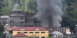 A building in Marawi City burns after Philippine Air Force warplanes bombed suspected Maute Group positions on Saturday (24 June 2017). MindaNews photo by FROILAN GALLARDO