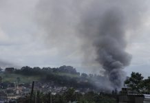 Smoke billows up in a portion of Marawi City that was hit by rockets fired from a gunship as fighting between government forces and the Maute group entered its ninth day on Wednesday (31 May 2017). MindaNews photo by H. Marcos C. Mordeno