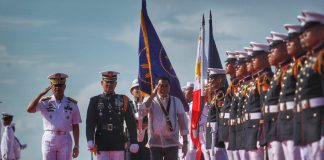 AS COMMANDER-IN CHIEF. President Rodrigo Duterte reviews and inspects honor guards upon his arrival during 119th anniversary of the Philippine Navy at Sasa Port in Davao City on Wednesday. LEAN DAVAL JR.