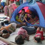 Child evacuees take a nap on the floor in one of the classrooms of the Iligan City National School of Fisheries in Barangay Buruun Tuesday afternoon (6 June 2017). Thousands of Maranaos have fled Marawi because of the ongoing skirmishes between government soldiers and the Maute Group. MindaNews photo by AUBREY ROCIN LLAMAS