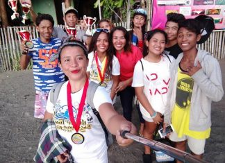WINNERS. Team Amihan of Mati City led by skipper Winston Plaza (4th from right, with cap) showing their trophies and medals.