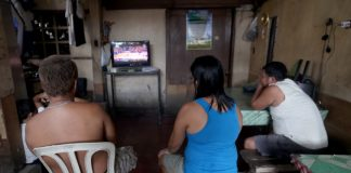 NBA FANS.Residents are glued to the television set as they watch the finals of the National Basketball Association at a community along R. Magsaysay Avenue in Davao City on Tuesday. LEAN DAVAL JR.