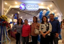 NEW VENTURE. Global Ventures, Inc. president Glenn Escandor (rightmost) poses for a photograph with his wife Michelle Ann (2nd from right), Escandor Group of Companies vice president Violeta Escandor (center), Thelma Derla (2nd from left) and Irra Jarina Escandor during the blessing and opening of the new Globe GEN3 Store at the third level of Gaisano Mall of Davao on Thursday. LEAN DAVAL JR.
