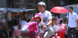 NO LOAD TOO HEAVY. A father and his two young daughters brave the blistering heat as he brings them to school on a bicycle on Tuesday afternoon. LEAN DAVAL JR.