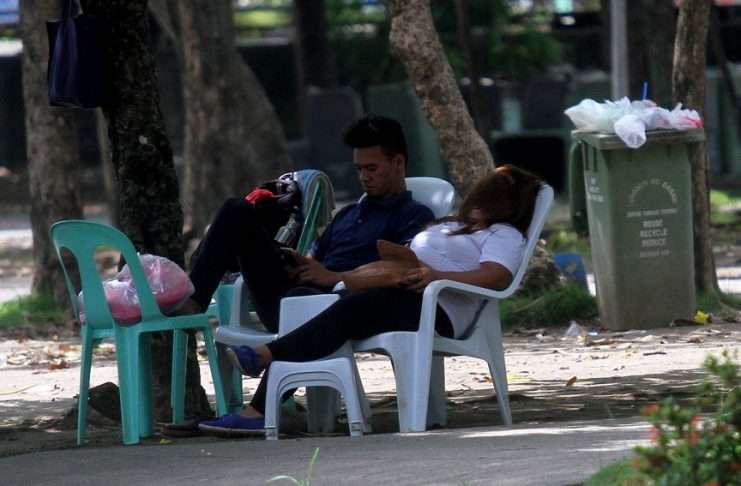 SIESTA TIME. A masseuse has fallen to sleep while waiting for customers during a slow day at Magsaysay Park in Davao City on Tuesday. LEAN DAVAL JR.