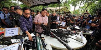 IMPRESSIVE WEAPONRY. National Security Adviser Hermogenes Esperon (center), Presidential Adviser on the Peace Process Secretary Jesus Dureza (left) and Defense Secretary Delfin Lorenzana inspect the recovered firearms from local terrorists in Marawi City over the weekend. PRESIDENTIAL PHOTOGRAPHERS
