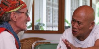 Fr. Peter Geremia, PIME, chats with Norberto Manero in Kidapawan Diocese on February 2008. Mindanews File Photo