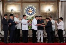 President Rodrigo Roa Duterte receives a draft of the new proposed Bangsamoro Basic Law (BBL) in a turnover ceremony at the Rizal Hall in Malacañan Palace on July 17, 2017. Joining the President are (from left) Presidential Adviser on the Peace Process Jesus Dureza, Moro Islamic Liberation Front (MILF) Chairman Murad Ebrahim, Bangsamoro Transition Commission (BTC) Chair Ghazali Jaafar and MILF Peace Implementing Panel Chair Mohagher Iqbal. KING RODRIGUEZ/PRESIDENTIAL PHOTO