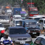 MOTORISTS HUB. Motorists are welcomed by heavy traffic congestion during peak hours near Ma-a Bridge along Jose P. Garcia Highway in Davao City on Monday morning which was caused by road construction. LEAN DAVAL JR.
