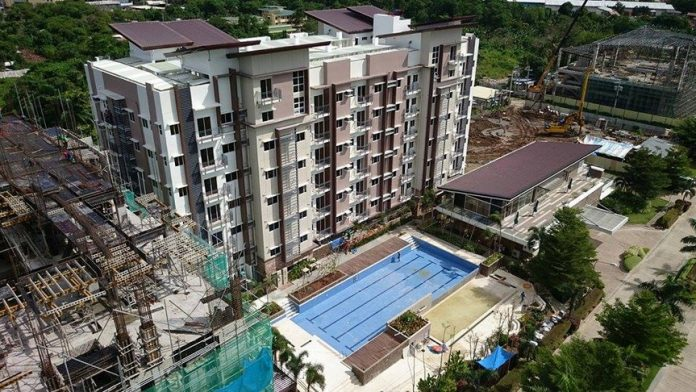 FIRST CONDO BUILDING. The Matina Enclaves' Building B/1 with the pool on foreground.