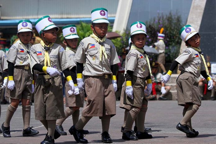 ACE UP THEIR SLEEVES. Boy scouts from Kapitan Tomas Monteverde Sr. Elementary School perform fancy drill routine during a competition in time for the 52nd foundation day celebration of the Davao City Boy Scout Council at Rizal Park in Davao City on Monday. LEAN DAVAL JR.