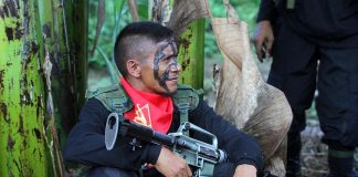 SCUTTLED. A member of the rebel New People's Army takes a rest after a tactical inspection during the 48th anniversary of the Communist Party of the Philippines in the hinterlands of Davao City in this undated photo. President Duterte said he is cancelling the peace talks with the National Democratic Front after a series of attacks staged by the NPA against the chief executive's Presidential Security Group (PSG) and personnel of Philippine National Police (PNP) recently. LEAN DAVAL JR.
