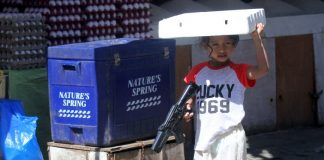 GIRLS WILL BE GIRLS. A young girl holds a toy gun while looking for her playmates during an afternoon of imaginary gunfight at Bankerohan Public Market in Davao City on Thursday. LEAN DAVAL JR.