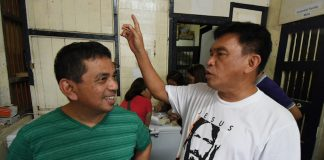 Naawan parish priest Father Roniedon Valmoria (left) talks to Monsignor Elmer Abacahin of the Archdiocese of Cagayan de Oro about his two-hour ordeal with an armed gunman who sought asylum in his convent in Naawan, Misamis Oriental on Wednesday, Aug. 23, 2017. The gunman identified as Loverton Ruedas, a musician, later surrendered to the priest ending the stand-off at the San Labrador parish church in Naawan. MindaNews photo by FROILAN GALLARDO