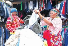 SIFTING THROUGH. An elderly Matigsalog woman, together with her son, from Bukidnon go over a collection of pre-loved short pants at a makeshift 'ukay-ukay' stall along Lizada Street in Davao City on Tuesday. LEAN DAVAL JR.