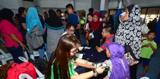 Internally Displaced Persons (IDPs) from Marawi City benefit from a community outreach program called 'Kalipayapaan' initiated by Task Force Davao led by Colonel Bernard Neri at the Davao City Recreation Center on Thursday. LEAN DAVAL JR