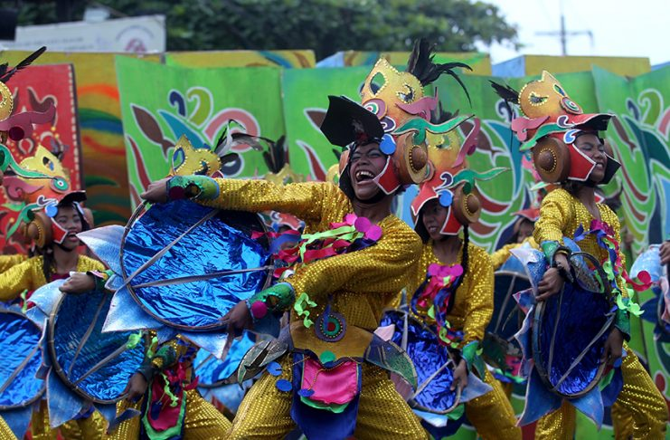 OUT-OF-TOWNERS. A contingent from Polomolok National High School performs various street dance routines during Indak-Indak sa Kadayawan along C.M. Recto Avenue in Davao City on Saturday. LEAN DAVAL JR.