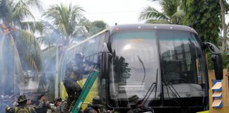WORST CASE SCENARIO. Members of Davao City Police Office (DCPO) Special Weapons and Tactics (SWAT) unit class 'Dalubhasa' conduct a final rehearsal of a rescue operation simulation against 'terrorists' inside a passenger bus at Camp Domingo Leonor Sr. on Wednesday. Davao City Mayor Sara Duterte-Carpio will be the guest of honor when 45 police officers will graduate today from a 45-day SWAT training. LEAN DAVAL JR.