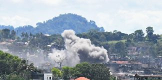Smoke from an exploding bomb dropped from a Philippine Air Force OV10 plane is seen from the countryside in Marawi City on Friday (1 Sept 2017). MindaNews photo by FROILAN GALLARDO