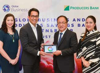 Globe Business Senior Vice President Peter Maquera (center, left) and PSBC Chairman and CEO Andres Cornejo (center, right) officially seal the G Suite partnership. Together with them are Globe Business Cluster Sales Head Tisha Sadorra (left) and PSBC Vice Chairman Sandra Mendoza (right).