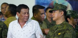 President Rodrigo Roa Duterte chats with Armed Forces Chief of Staff General Eduardo Año on the sidelines of the 11th Founding Anniversary celebration of the Eastern Mindanao Command (EastMinCom) at the Naval Station Felix Apolinario in Panacan, Davao City on September 1, 2017. JOEY DALUMPINES/PRESIDENTIAL PHOTO