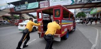 CONKED OUT. Traffic enforcers from the City Transport and Traffic Management Office (CTTMO) help a motorist by pushing his passenger jeepney, which broke down in the middle of the road, to the side of the street as traffic starts to build up along J.P. Laurel Avenue in Davao City on Wednesday. LEAN DAVAL JR.