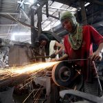 CUTTING EDGE.Blacksmiths sharpen newly formed large single-edged knives locally known as 'bolo' using grinders inside an establishment manufacturing various kinds of bladed products in Ma-a, Davao City on Monday. LEAN DAVAL JR.