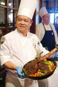 Pacific Star Resort and Spa's chef Leyland Feng shows off his signature 28-day wet aged Tomahawk steak.