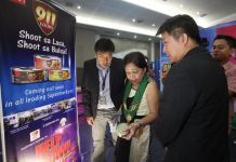 NEWS PRODUCTS. Senator Cynthia Villar, accompanied by Jonathan Suy (left) of Ana's Breeder Farm, Inc. and Davao Agri Trade Expo (DATE) 2017 chair Engr. Wilfred Teves (right), checks the products on display at the exhibition area during the second day of DATE 2017 at SMX Convention Center in Lanang, Davao City on Friday. LEAN DAVAL JR