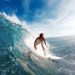 """Siargao surfer gliding through a """"small"""" day in Cloud 9. Photo by Bren Lopez."""