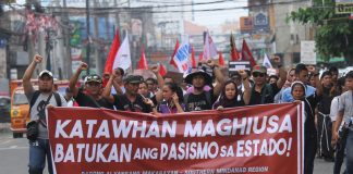 BEYOND FORGETTING. Members of progressive groups stage a mass protest to commemorate the 45th anniversary of the declaration of Martial Law along C.M. Recto Avenue in Davao City on Thursday. LEAN DAVAL JR