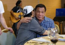 GRATEFUL. President Duterte shows a gesture of compassion to singer April Boy Regino during a gathering with members of the media at the Matina Enclaves in Davao City on Friday night. Regino, who is suffering from visual impairment caused by an illness, thanked the president for his help and support. PRESIDENTIAL PHOTO