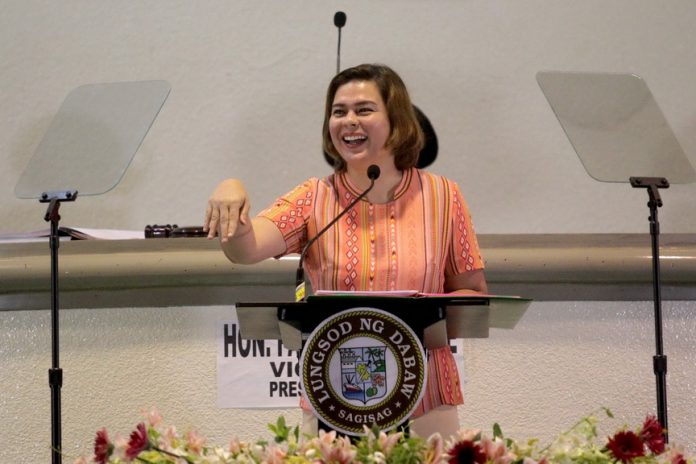 STATE OF THE CITY. Davao City Mayor Sara Duterte-Carpio, wearing an orange city government employee uniform, gestures as she delivers her State of the City Address (SOCA) at Sangguniang Panlungsod session hall on Tuesday. The mayor detailed her administration's accomplishments and presented future plans and programs for the city. LEAN DAVAL JR.