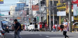 DEFIANCE? Pedestrians jaywalk while crossing C.M. Recto Avenue in Davao City despite the stricter implementation of Anti-Jaywalking Ordinance and other traffic ordinances on Monday. LEAN DAVAL JR.