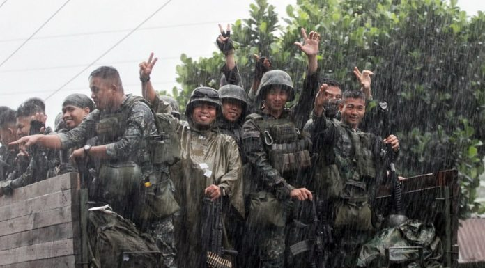 HOMEWARD BOUND. Victorious Marines celebrate as they leave a rainy Marawi City, and back to their home base, on Thursday (19 October 2017). MindaNews photo by MANMAN DEJETO