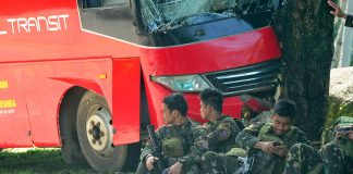 Army Scout Rangers sit beside their damaged bus along the Marawi-Iligan highway on Wednesday (25 October 2017). The Rangers, fresh from five months of fighting in Marawi, were returning home when their bus figured in an accident. Two soldiers and the bus driver were slightly injured. MindaNews photo by FROILAN GALLARDO