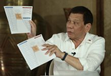 COMPLEX SET-UP. President Duterte shows a matrix of the politicians involved in the illegal trade as he explains how the operations are being carried out during Erwin Tulfo's program 'Sa Totoo Lang' which was aired on the People's Television on Fridaynight. RICHARD MADELO/PRESIDENTIAL PHOTO