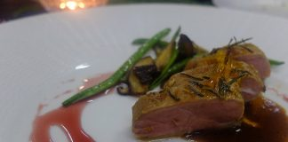 Roast breast of duck with roasted mushroom and French beans, lemon confit and pinot noir sauce