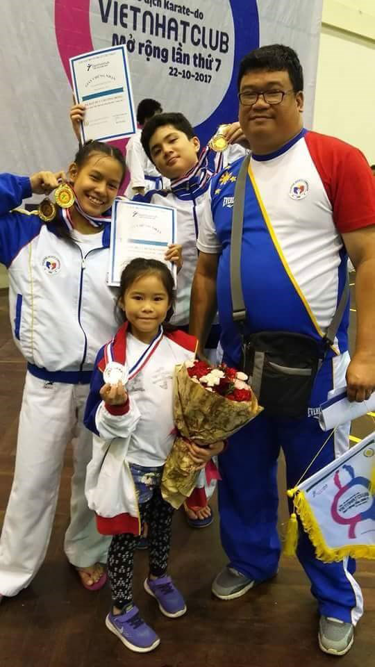 WINNING POSE. AAK Davao's Sofia Aguo, John Paul Ponce and Atsuko Kaiyel Tan with head coach Rommel Tan after winning five medals in the 7th Vietnam Open.