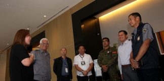 GOING THROUGH THE MOTIONS. Park Inn by Radisson Davao general manager Emelyn Rosales (leftmost) discusses security and safety matters with security experts led by Public Safety and Security Command Center (PSSCC) head Benito de Leon (rightmost) before the start of an armed attack simulation drill at the hotel on Thursday. LEAN DAVAL JR.