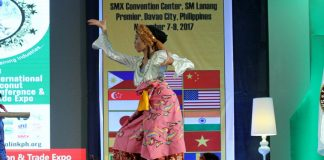 OPENER.An ethnic dancer performs tribal dances in front of miniature flags of participating countries printed on a tarpaulin during the opening of Cocolink: 2nd International Coconut Conference at SMX Convention Center in Lanang, Davao City on Tuesday. LEAN DAVAL JR.