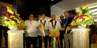 CURTAIN-RAISER. Philippine Coconut Authority (PCA) administrator Romulo dela Rosa (3rd from right), ACDI/VOCA chief of party Thelonious Trimmell (rightmost), Davao Region Coconut Industry Cluster, Inc. (DRCICI) chair Bonifacio Fernandez (2nd from left) and Councilor Conde Baluran representing Mayor Sara Duterte-Carpio lead the cutting of the ribbon during the opening of the two-day Cocolink: 2nd International Coconut Conference at SMX Convention Center in Lanang, Davao City on Tuesday. LEAN DAVAL JR.