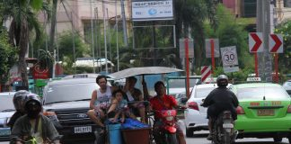 FULLY-LOADED. A couple, who appears to be in the fish trading business, with their young child in tow traverse E. Quirino Avenue, Davao City on a tricycle loaded with fish baskets on Tuesday. LEAN DAVAL JR.